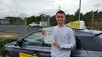 Will Jones with his driving test pass certificate